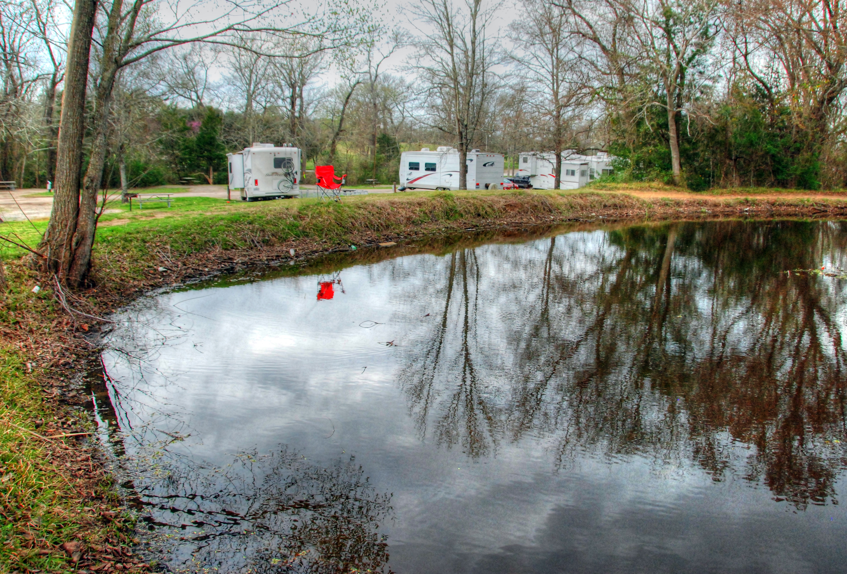 Glamping at an rv resort shore looks nice for Bass fishing ponds